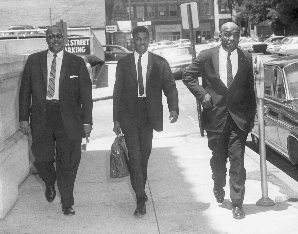 Black and white photograph of Frank D. Reeves, Henry L. Marsh III, and Samuel W. Tucker walking next to each other down a street.