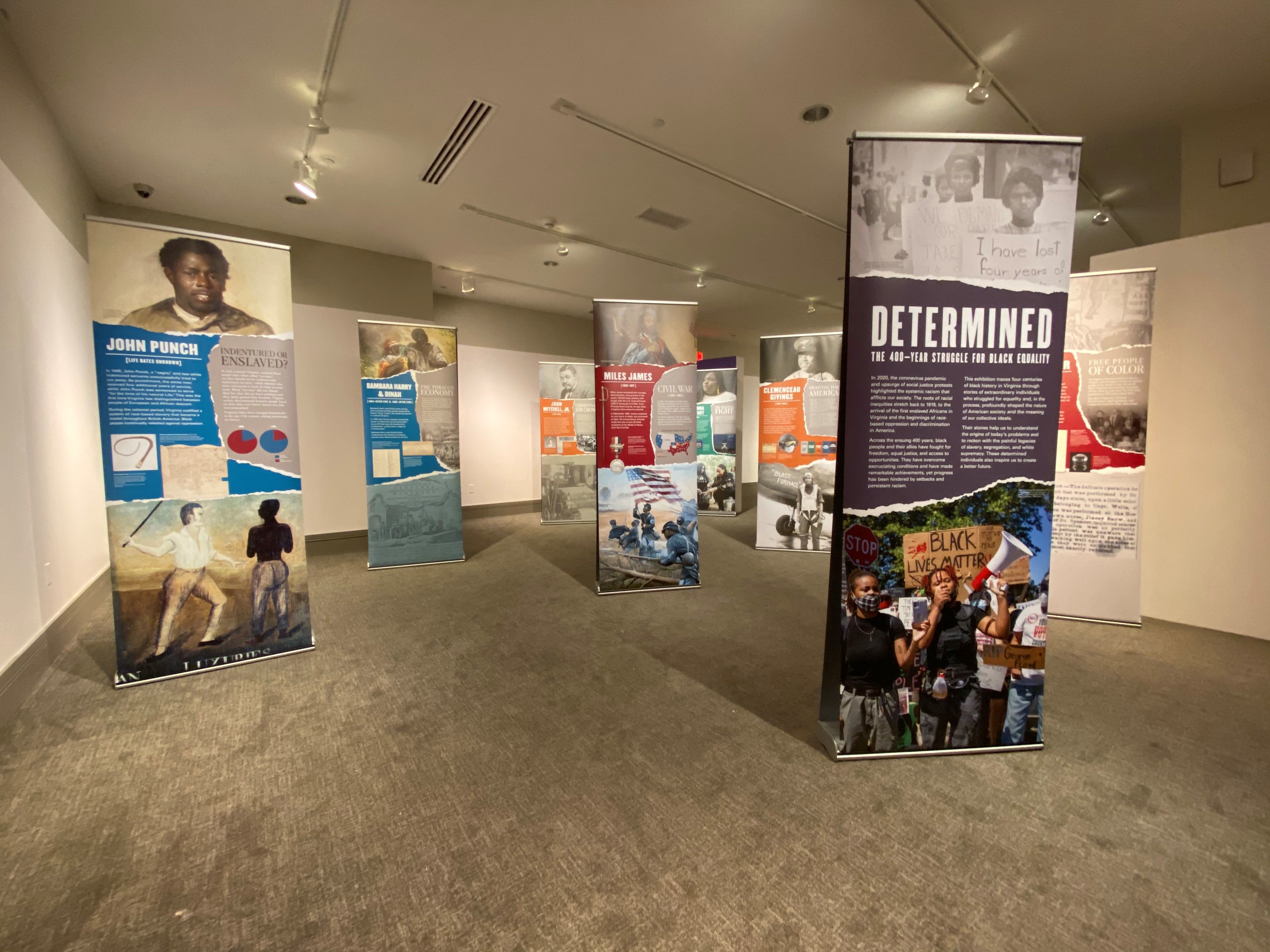 Determined Traveling Exhibition Banners on full display in gallery