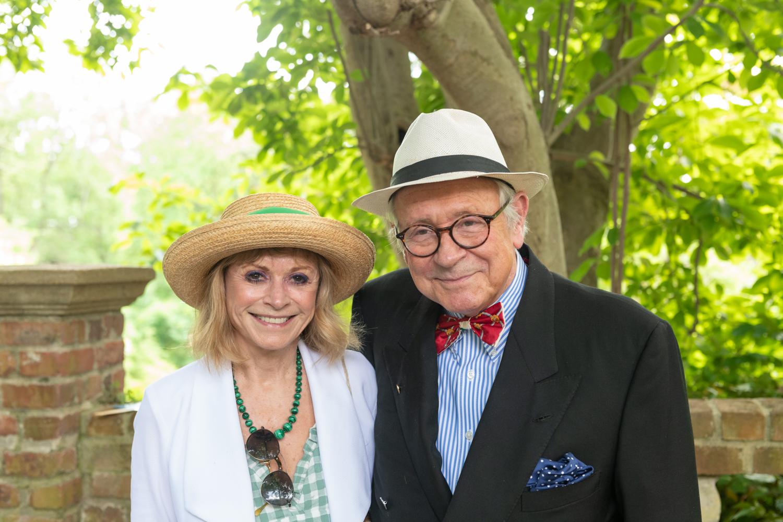 A couple enjoys the Annual Garden Party at Virginia House.