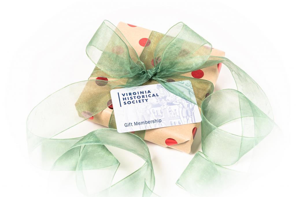 wrapped box adorned with ribbon and a membership card