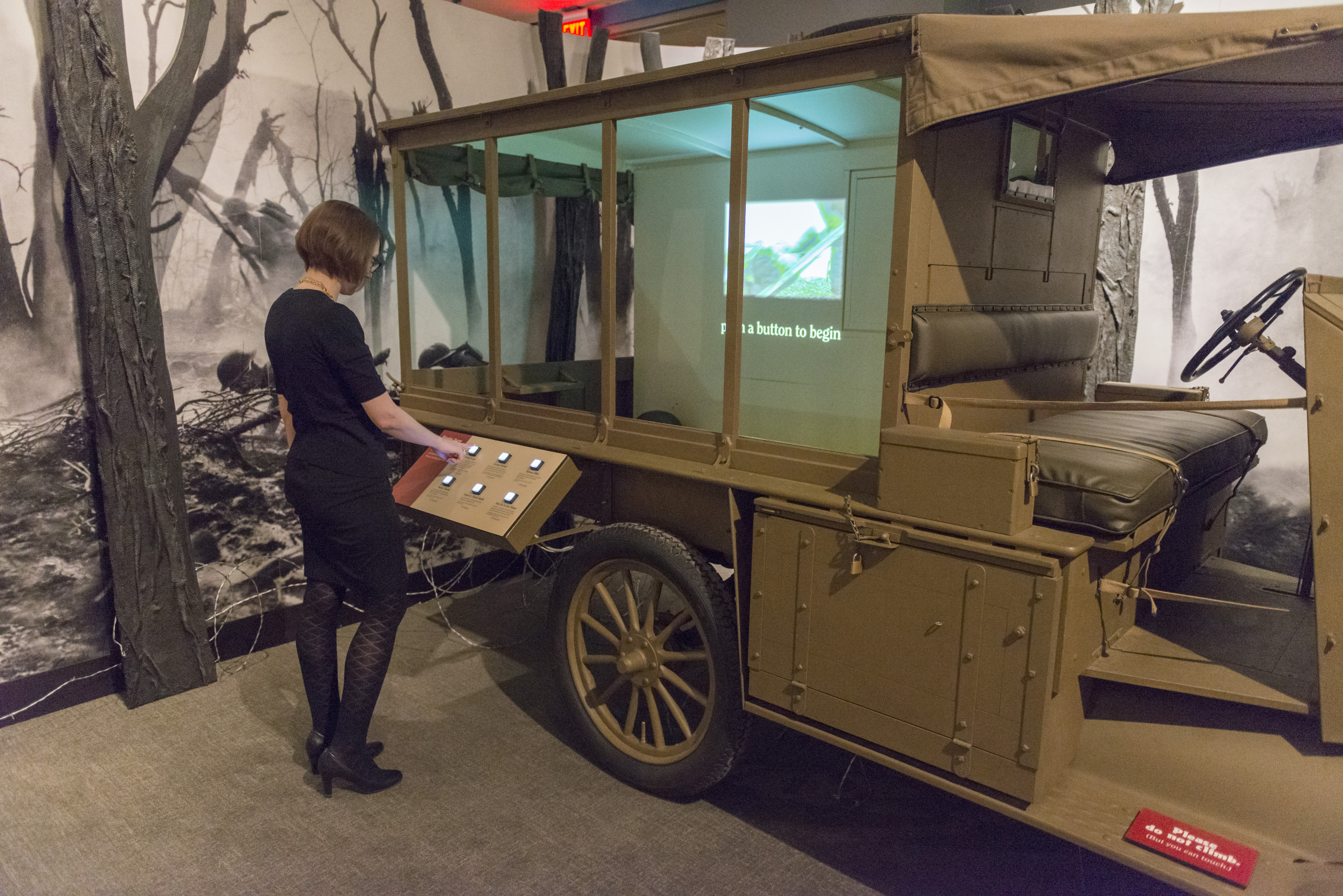 Member viewing army jeep in WWI America exhibition.