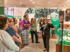 Curator Karen Sherry leads a group tour through the Determined exhibit.