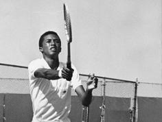 Arthur Ashe playing tennis