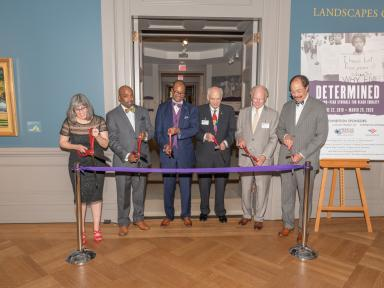 Sponsors and partners cut the ribbon to open the Determined Exhibition in 2019