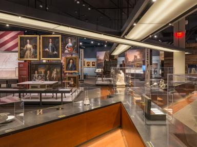 Story of Virginia Gallery in VMHC. View shows colonial portraits in background and glass cases in foreground