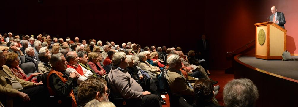Image of speaker and audience at a Banner Lecture