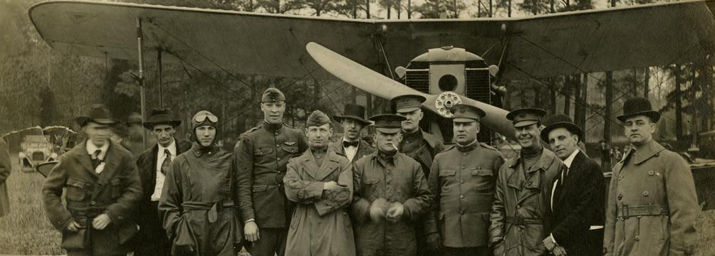 Photograph of Lt. Sylvanus Ingram and an early biplane, about 1918–1920 (VHS 2006.177.1_v1)