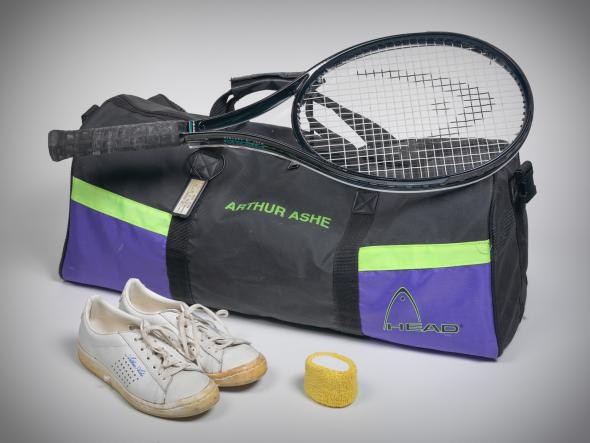 Tennis raquet, sports bag and shoes - belonged to Arthur Ashe