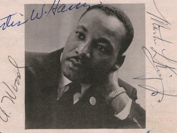 Black and white photograph of Dr. Martin Luther King, Jr. and five signatures (clockwise from top right): Martin L. King, Jr.; Wyatt Tee Walker; Ralph Abernathy; Virgil A. Wood; Curtis W. Harris.
