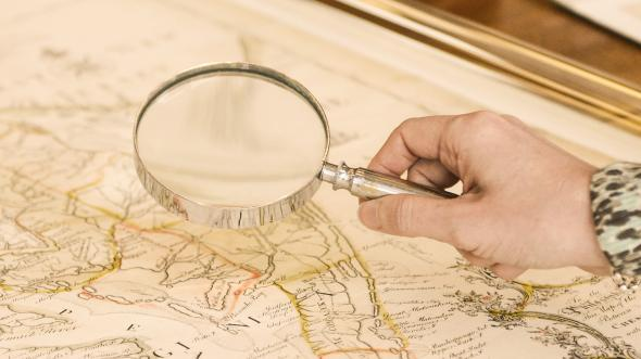 Magnifying glass  being held over a map