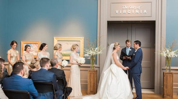 Bride and groom during ceremony in landscape gallery at the VMHC