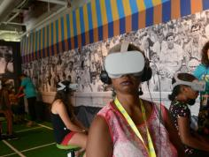 Woman using a VR viewing headset. Image courtesy of Ashe '68.
