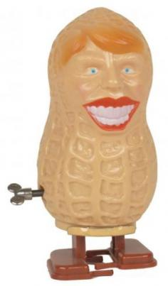 A Jimmy Carter campaign windup toy in the shape of a peanut.