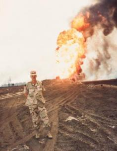 Photograph of Christopher Werle in Kuwait with burning oil wells, 1991
