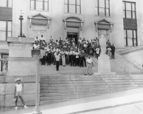 Black and white photograph of assembly members standing on the steps of a municipal building at the Danville protest, June 10, 1963