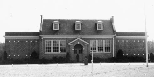 Black and White Image of the Front of the George W. Watkins School