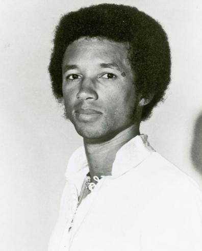 Black and White Portrait Photograph of Arthur Ashe, Jr. (1943-1993) Looking Into The Camera.