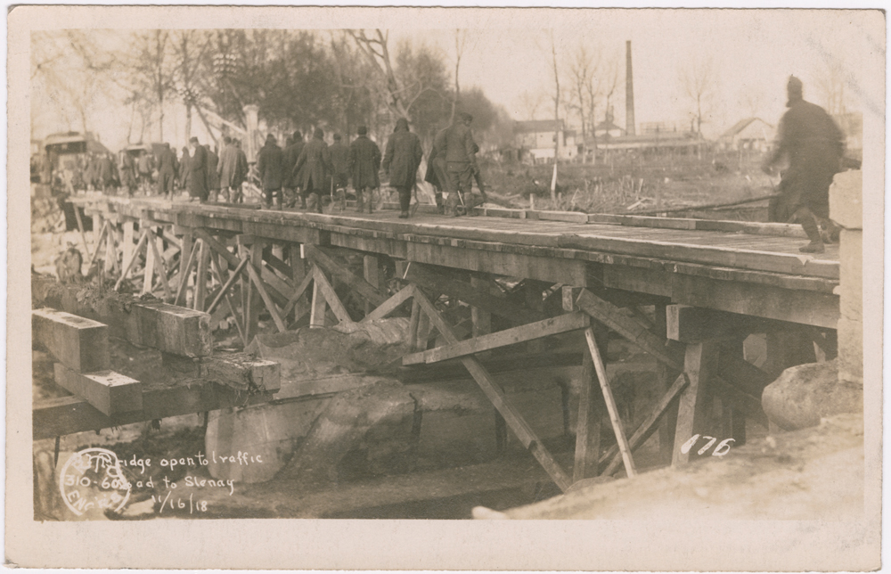"Shown here is a bridge built by Hugh's Co. B from Barricourt to Stenay. The caption reads ""Bridge open to traffic / road to Stenay / 11/16/18."""