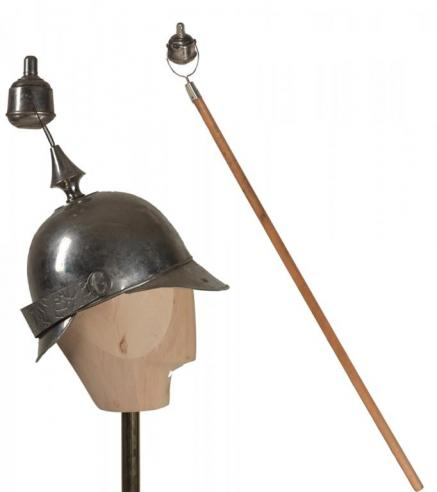 A nickel-plated torch helmet and hand held torch used for nighttime parades for the Grover Cleveland campaign