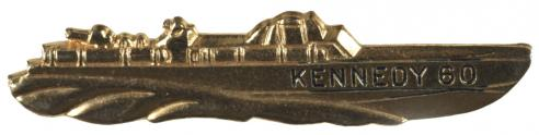 A pro-Kennedy tie clasp in the shape of a PT boat from World War II