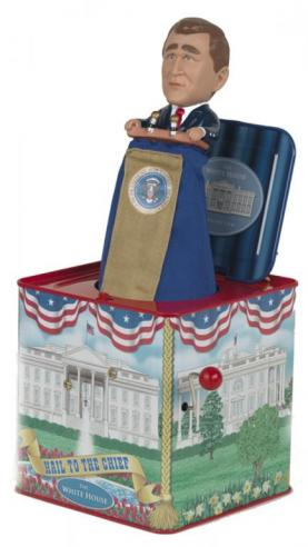 A Jack in the Box novelty item featuring a popup doll of George W. Bush
