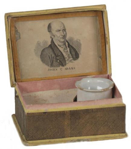 A pressed-cardboard sewing box with a portrait of John Quincy Adams