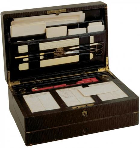Open lap desk belonging to Robert E. Lee while president of Washington College showing personal documents and tools organized inside.