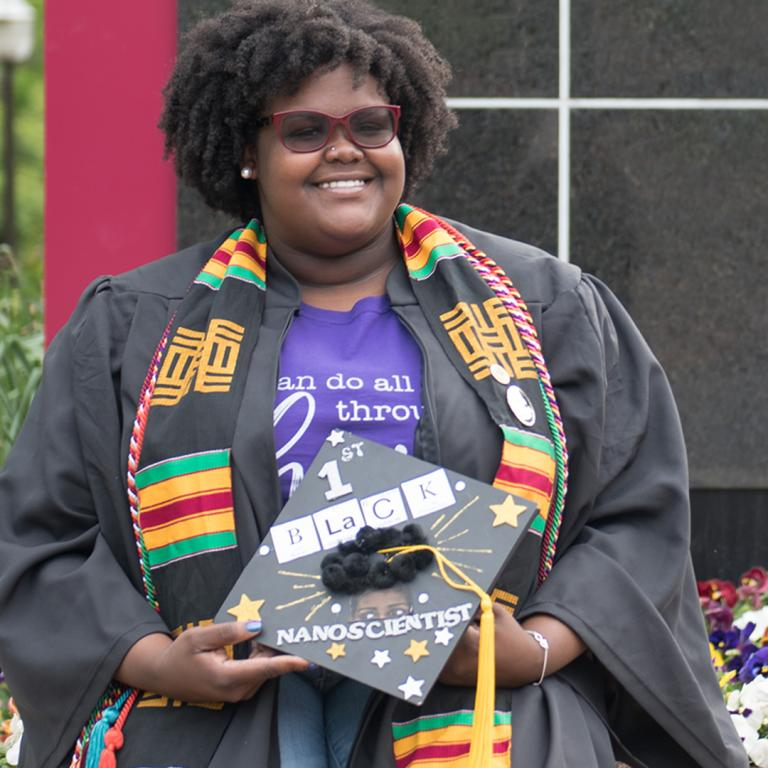 """In 2018, Ginai Seabron became Virginia's first black female nanoscience graduate when she graduated from Virginia Tech. Seabron personalized her mortarboard with letters from the periodic table and other decorative details. Learn more about her story (and see her graduation cap that she gifted to VMHC) in the """"Determined"""" exhibition. Details at VirginiaHistory.org/Determined."""