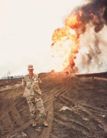 Photograph of Christopher Werle in Kuwait with burning oil wells, 1991 (VMHC 2019.29)